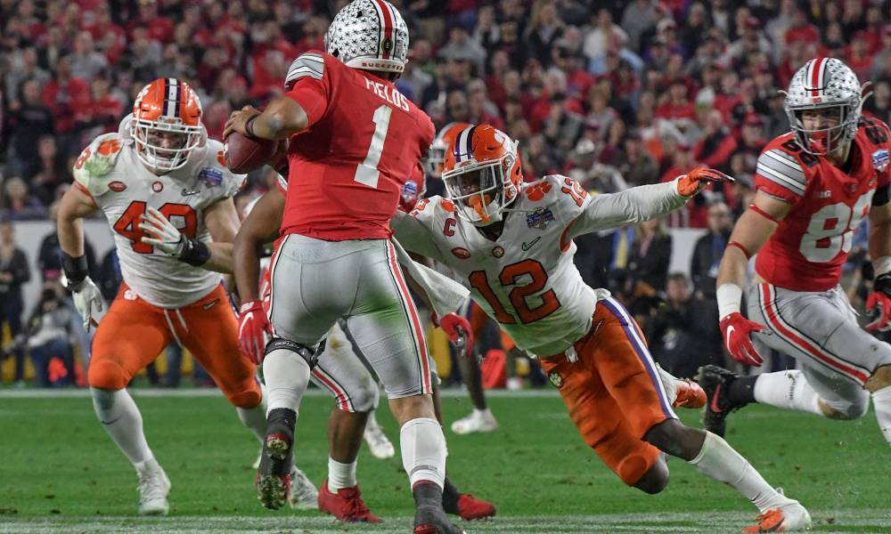 Clemson running a play and Ohio st comes. to block