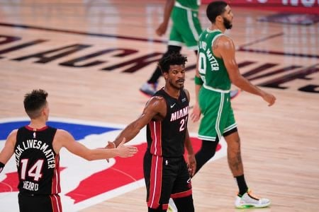 Miami Heats #'s 14 & 27 hiving fiving after scoring on Celtics