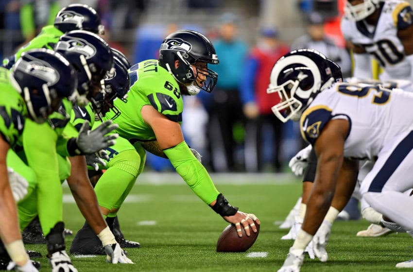 Rams Vs Seattle both teams on the defense line ready to start