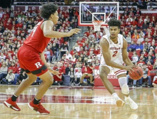 rutgers vs wisconsin battleing it out on the basketball court