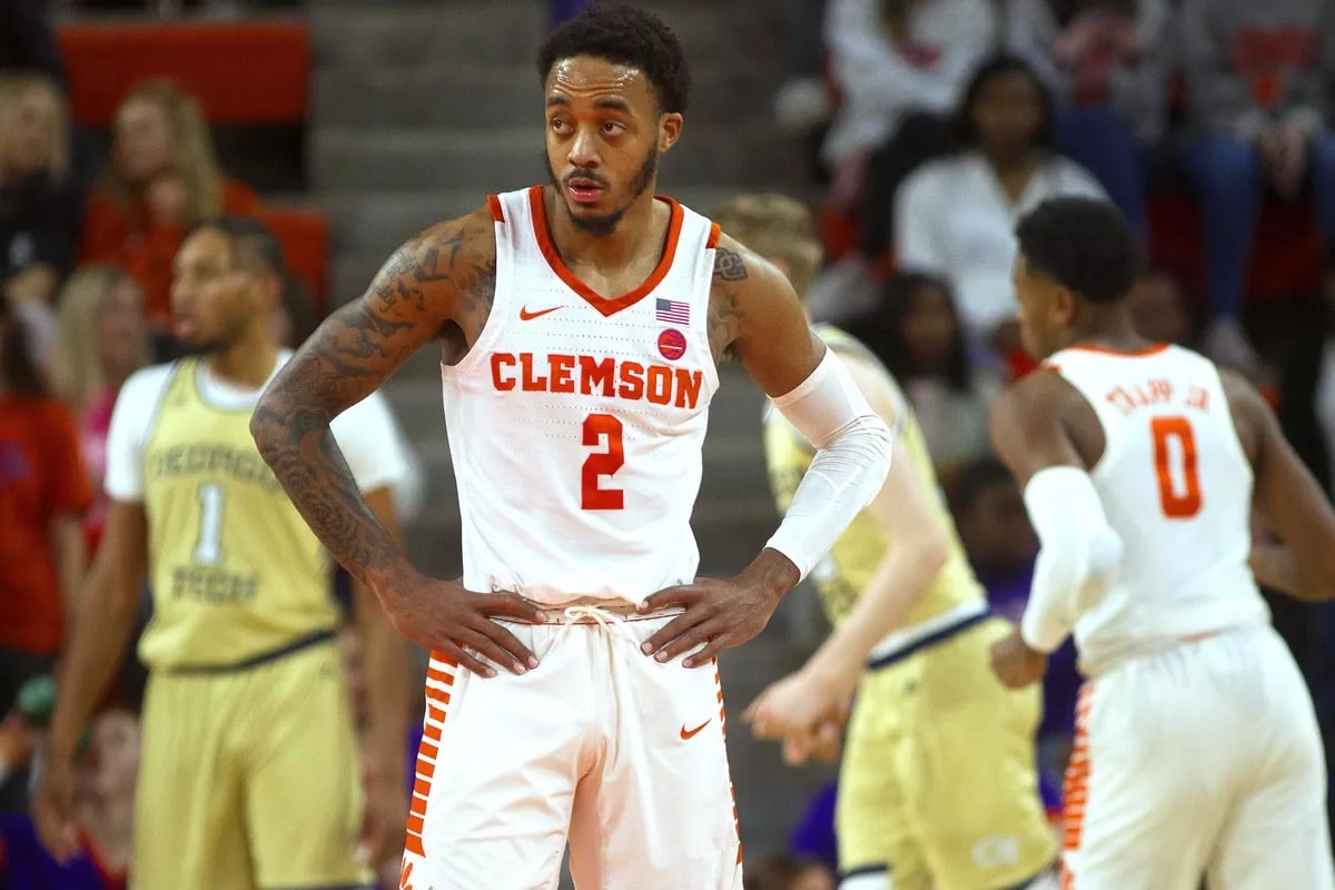 Clemson Can't believe it #2 stands Next to the Yellow Jackets
