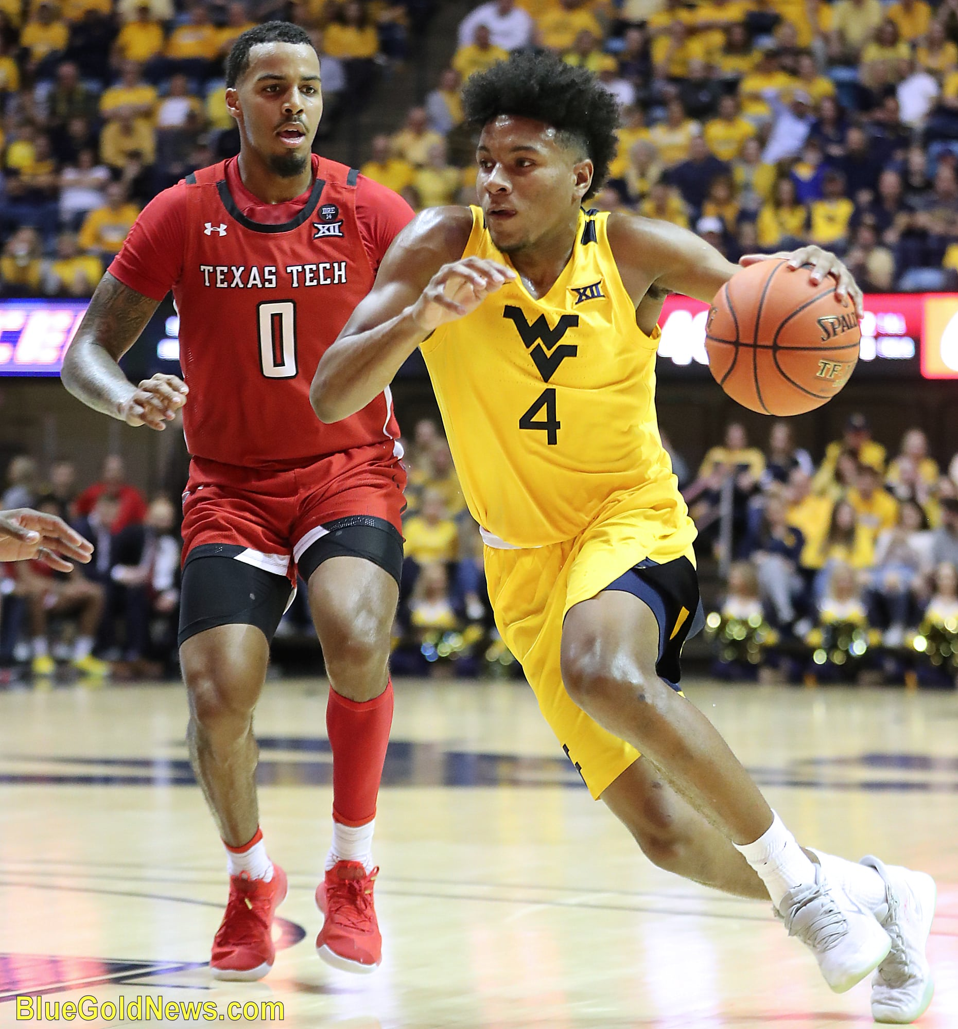 Mountaineers 4 comes in for the layup while texas Tech just looks