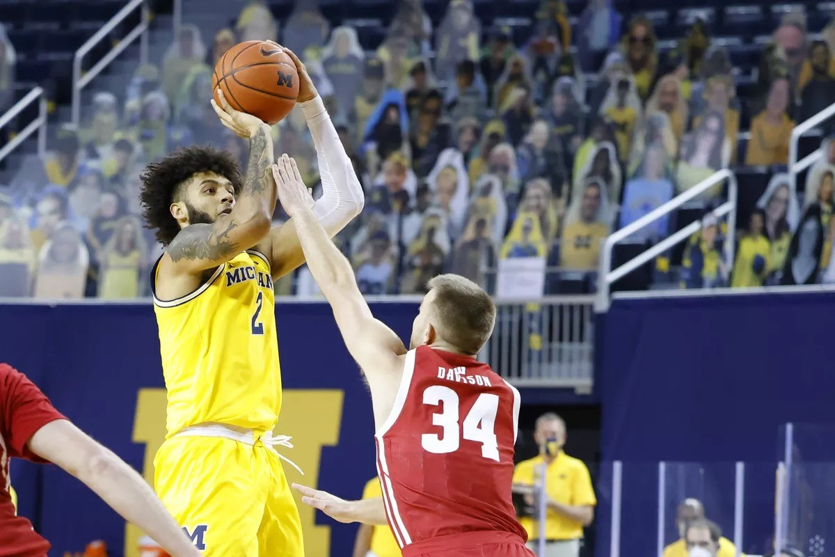 Michigan vs Wisconsin player up for the shot