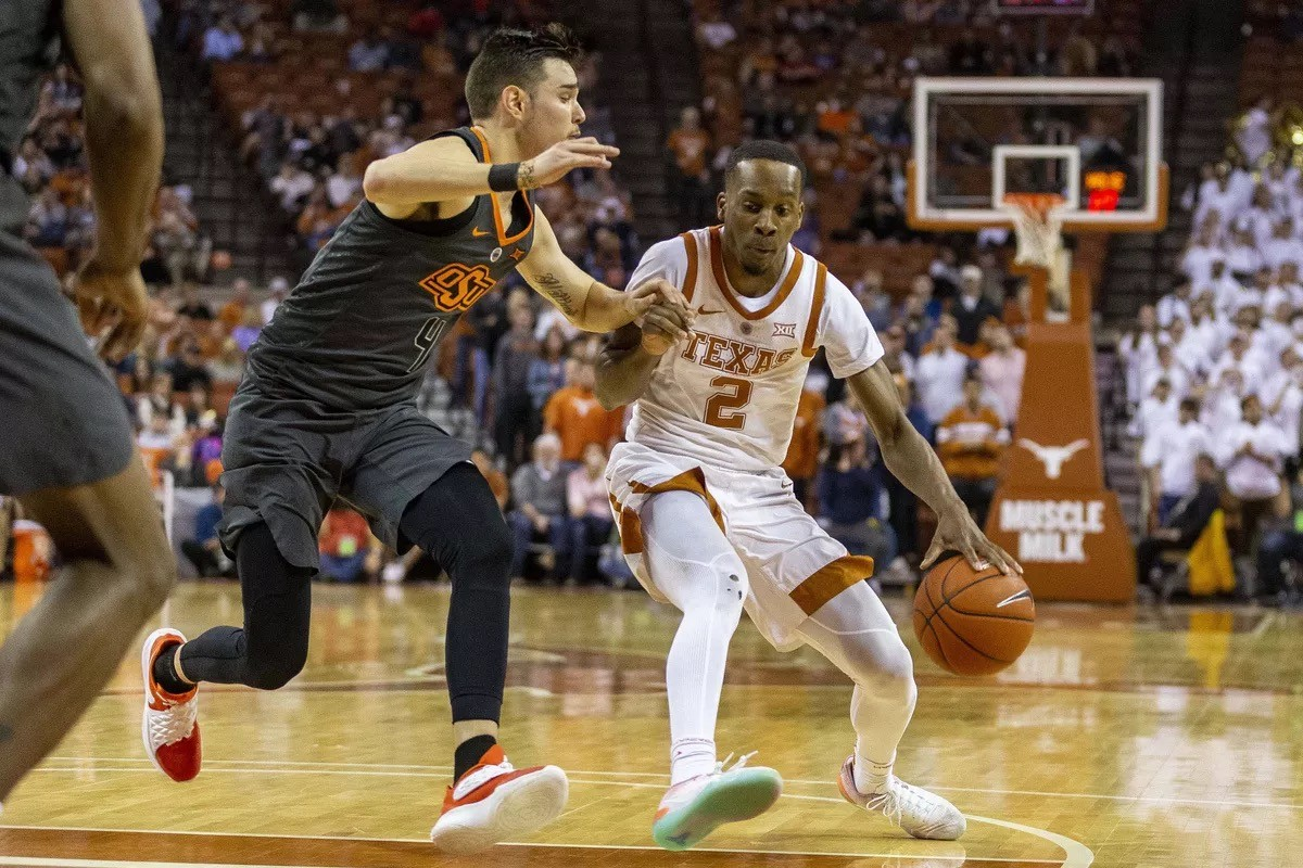 Texas is trying to get a shot from the in zone but Oklahoma is stopping him.