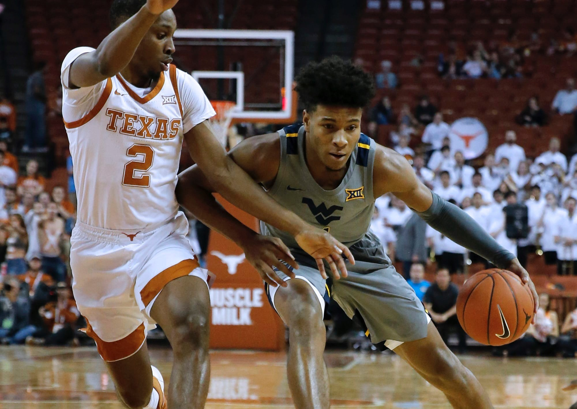 Texas 2 attacking WVU and about to take away the ball.